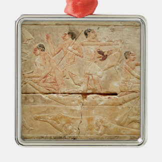 Relief depicting men in a boat christmas ornament