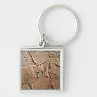 Relief depicting peasant leading cow to Silver-Colored square key ring