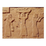 Relief depicting porters laden with gifts postcard