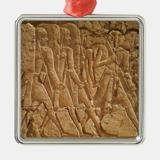 Relief depicting servants carrying rope christmas ornament