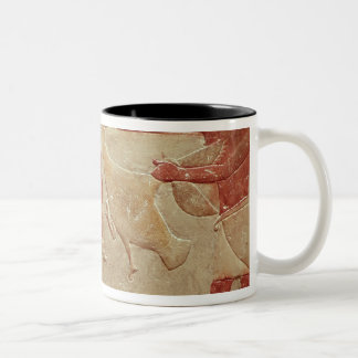 Relief depicting servants mugs