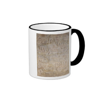 Relief depicting the unloading of wood ringer coffee mug