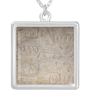 Relief depicting the unloading of wood silver plated necklace