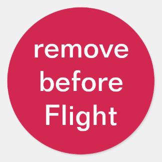 remove before Flight Round Sticker