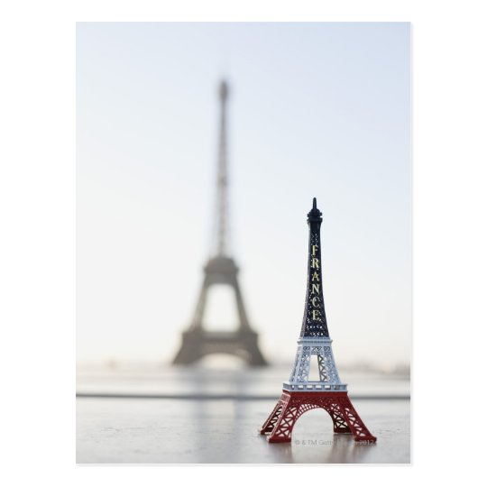 Replica of Eiffel Tower with original one in the Postcard