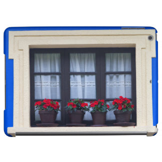 Residential housing with flowers in windows