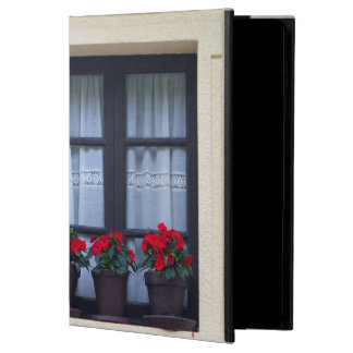 Residential housing with flowers in windows iPad air cases