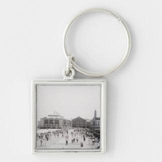 Resort tourists on esplanade key ring