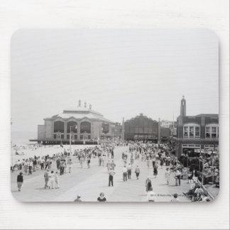 Resort tourists on esplanade mouse mat