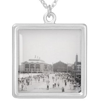 Resort tourists on esplanade silver plated necklace