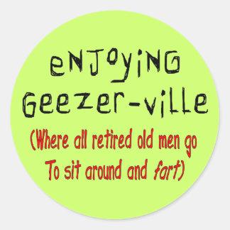 """Retired Mens T-Shirts & Gifts """"Geezer-Ville"""" Round Sticker"""