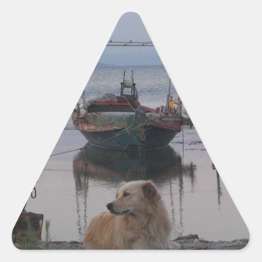 Retriever by the sea. triangle sticker
