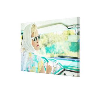 Retro 1950s model driving a vintage turquoise car… canvas print