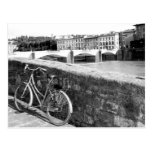 Retro Bicycle next to a bridge in Florence Post Card