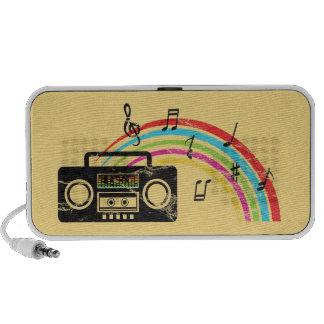 Retro boombox with music and rainbow notebook speaker