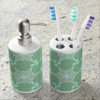 Retro flowers and spots on pastel green soap dispenser and toothbrush holder