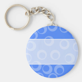 Retro pattern. Circle design in blue. Keychains