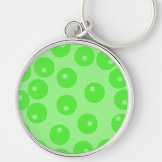 Retro pattern. Circle design in green. Keychains