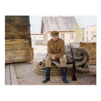 Retro style picture with soldier sitting on the ro postcard