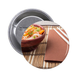 Rice vermicelli hu-teu in a small brown bowl 6 cm round badge