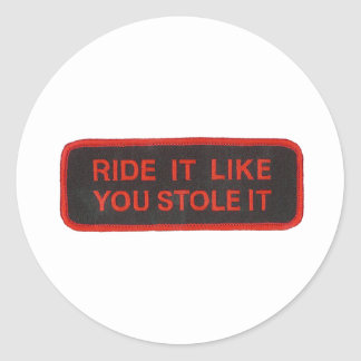 ride it like you stole it round sticker