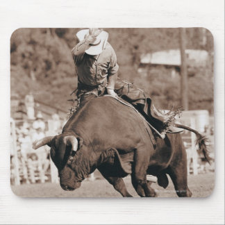 Rider about to fall off bucking bull mouse mat