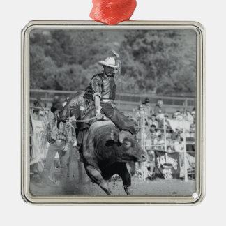 Rider hanging on to bucking bull 2 Silver-Colored square decoration