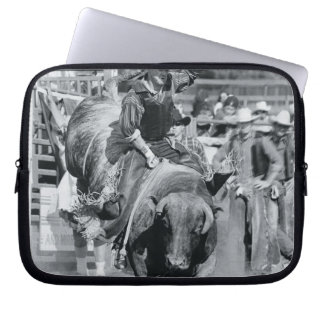 Rider hanging on to bucking bull laptop sleeve