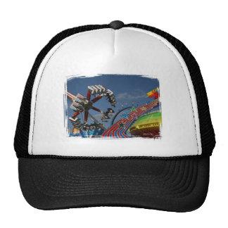 Rides at a county fair against a blue sky trucker hat
