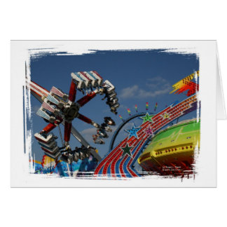 Rides at a county fair against a blue sky cards