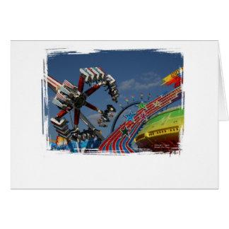 Rides at a county fair against a blue sky greeting card