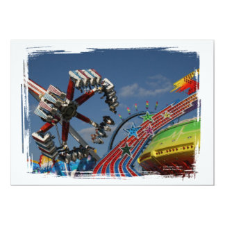 Rides at a county fair against a blue sky card