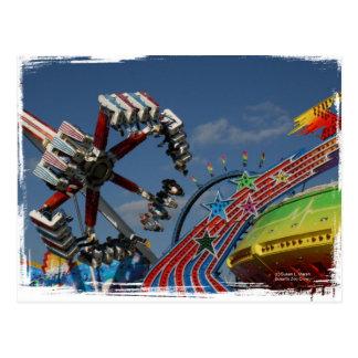 Rides at a county fair against a blue sky postcard