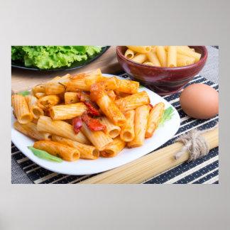 Rigatoni pasta, seasoned with pepper and arugula poster