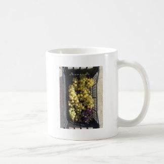 Ripe grapes in box coffee mug