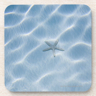 Rippled blue water with starfish coaster