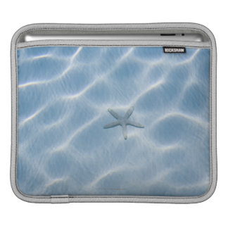Rippled blue water with starfish iPad sleeve