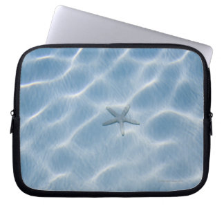Rippled blue water with starfish laptop sleeve