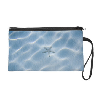 Rippled blue water with starfish wristlet purse