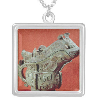 Ritual 'kuang' wine mixer in the shape of silver plated necklace