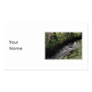 River flowing through woodland. pack of standard business cards