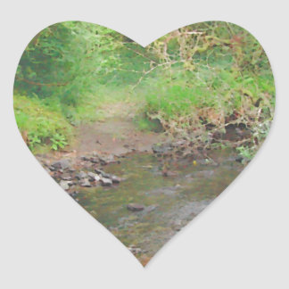 River in woodland. heart sticker
