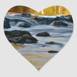 RIVER TURNING INTO LIQUID GOLD HEART STICKER