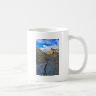 Riverbed view of Zabriskie Point Mugs