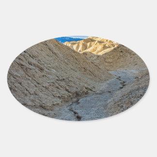 Riverbed view of Zabriskie Point Oval Sticker