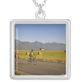 Road bicyclists ride down a back country road silver plated necklace