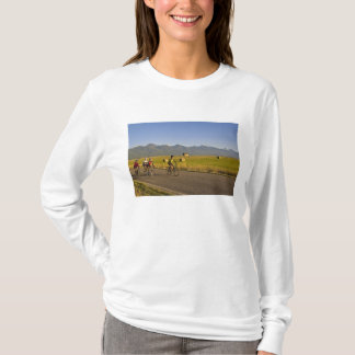 Road bicyclists ride down a back country road T-Shirt