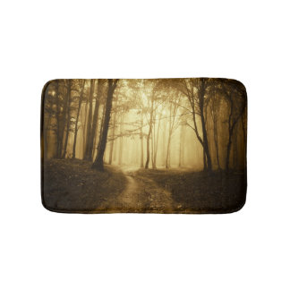 Road in a dark forest with fog bath mats