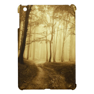 Road in a dark forest with fog iPad mini covers