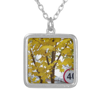 Road speed limit sign on a city street square pendant necklace